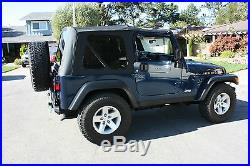 1997-2006 Jeep Wrangler (TJ) Replacement Soft Top with Tinted Rear Windows Black