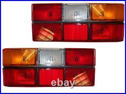 VOLVO 240 244 tail light pair black center molding new 1372450-449 Sale